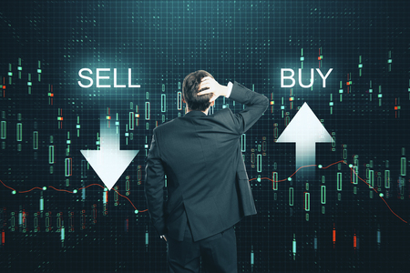Back view of thoughtful businessman on creative buy sell forex chart background. Growth and invest concept
