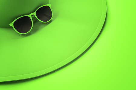 Close up of bright green beach hat and sunglasses on surface. Holiday, vacation and accessory concept. 3D Rendering