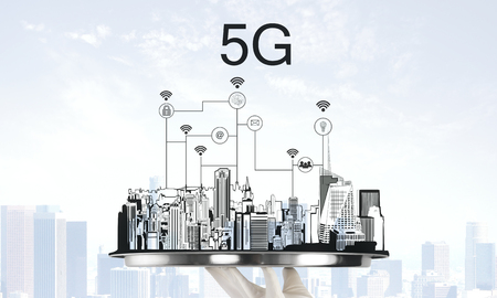 Hand holding tray with creative city drawing and 5G internet connections. Communication and network concept