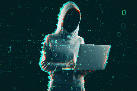 Hacking and computing concept. Hacker in hoodie using laptop with creative binary code. Double exposure