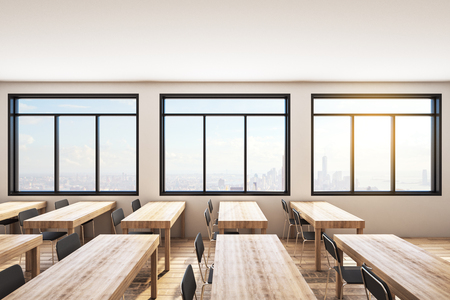 Modern wooden classroom interior with desks, chairs and bright city view. Education and knowledge concept. 3D Rendering Stock Photo