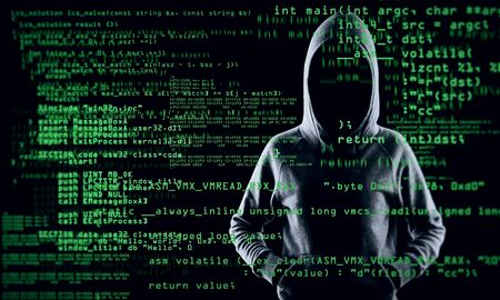 Coding and theft concept. Hacker with abstract coding text on blurry background. Multiexposure