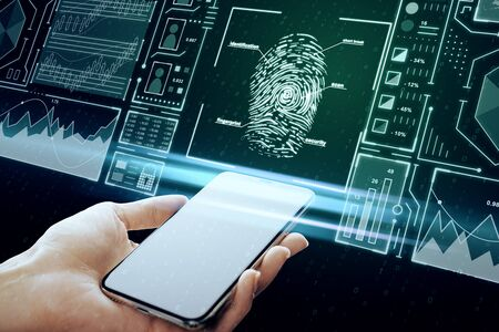 Hand holding smartphone with creative finger print scan hologram on blue background. ID and safety concept. Multiexposure