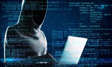 Computing and criminal concept. Hacker with laptop and abstract coding text on blurry background. Double exposure Stock Photo