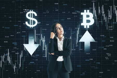 Dollar and bitcoin concept. Thoughtful young businesswoman making decision on abstract forex chart grid background Reklamní fotografie