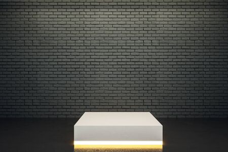 Blank illuminated pedestal in interior with copy space on brick wall. Mock up, 3D Rendering