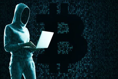 Attack and cryptocurrency concept. Hacker using laptop with creative coding bitcoin sign Stock Photo