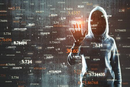 Hacker with abstract big data interface on blurry background. Software and innovation concept. Double exposure Stock Photo