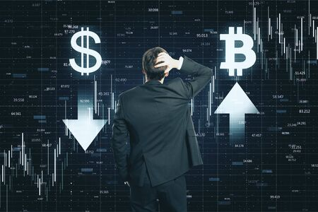 Trade and invest concept. Back view of thoughtful young businessman making decision on abstract forex chart grid background