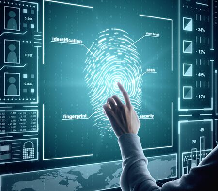 Hand using creative finger print scan hud on blue background. ID and protection concept. Double exposure 写真素材