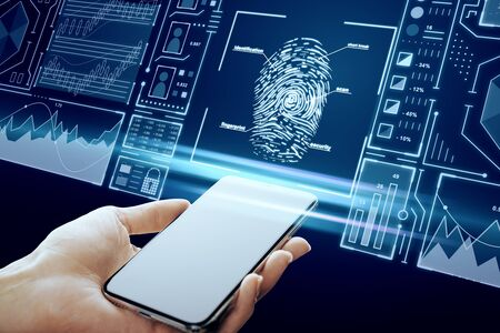 Hand holding smartphone with creative finger print scan hologram on blue background. ID and access concept. Multiexposure Stock Photo