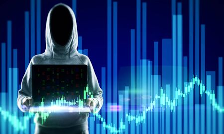 Hacker in hoodie holding laptop with glowing forex chart. Attack and invest concept. Double exposure