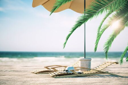 Chaise loingues, hat and umbrella on beautiful sandy beach with palms. Blurry background. Vacation concept. 3D Rendering 写真素材