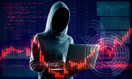 Hacker in hoodie holding laptop with glowing forex chart. Attack and invest concept. Multiexposure Stock Photo