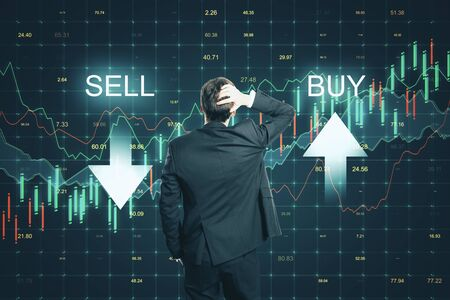 Sell and buy concept. Back view of thoughtful young businessman making decision on abstract forex chart grid background Reklamní fotografie