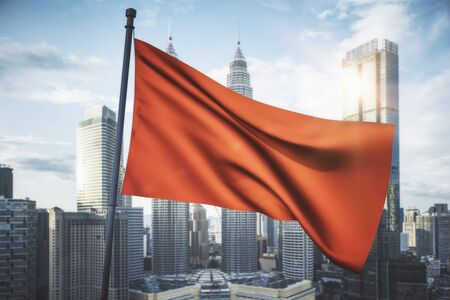 Empty waving red flag on bright blue sky and city background. Mock up, 3D Rendering Banco de Imagens