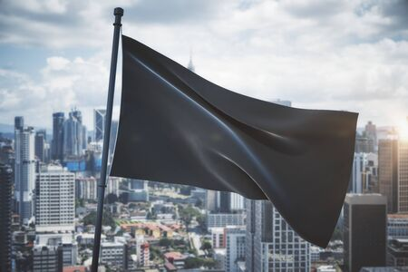 Empty waving black flag on bright blue sky and city background. Mock up, 3D Rendering
