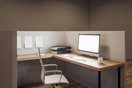 Contemporary office workplace with empty white computer screen, coffee cup and supplies on desktop. Mock up, 3D Rendering