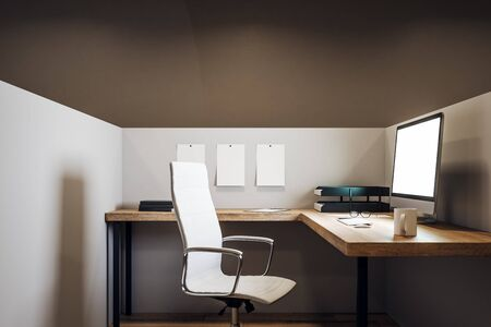 Minimalistic office workplace with empty white computer screen, coffee cup and supplies on desktop. Mock up, 3D Rendering