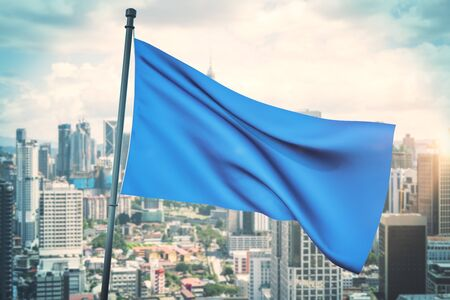 Empty waving blue flag on bright blue sky and city background. Mock up, 3D Rendering Banco de Imagens