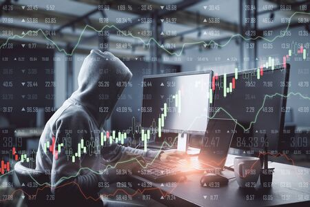 Side view of hacker in hoodie using laptop with glowing forex chart in blurry office interior. Malware and trade concept. Multiexposure