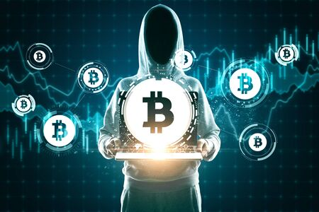 Hacker holding laptop with abstract bitcoin sign icons and forex chart. Trade and finance concept. Multiexposure Stok Fotoğraf