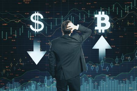 Stock market concept. Back view of thoughtful young businessman making decision on abstract forex chart grid background