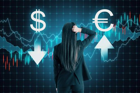 Back view of young businesswoman thinking about digital currency signs on forex chart background. Cryptocurrency and trade concept. Double exposure Stock Photo