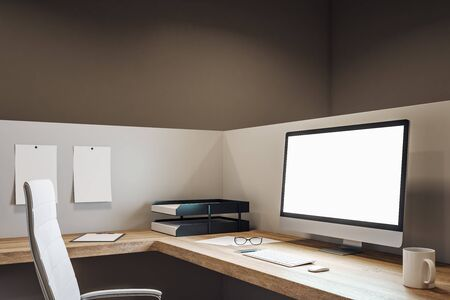 Clean office workplace with empty white computer screen, coffee cup and supplies on desktop. Mock up, 3D Rendering Imagens