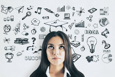 Knowledge and science concept. Potrait of attractive young businesswoman with creative education sketch on white background Imagens