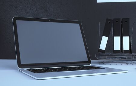 Close up of modern designer desktop with empty laptop and supplies. Mock up, 3D Rendering Stock Photo