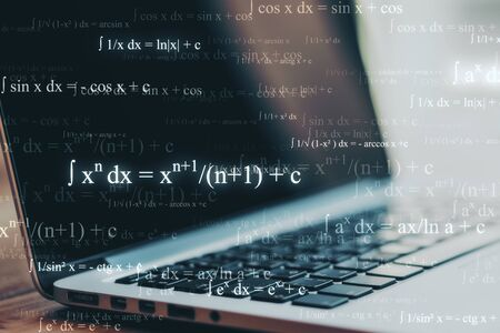Programming and technology concept. Close up of blurry laptop with mathematical formulas. Multiexposure