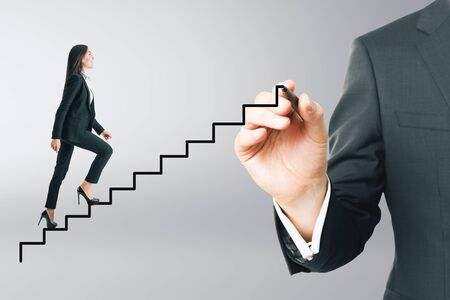 Side view of young businesswoman running up abstract ladder on gray background. Growth and success concept. Stockfoto