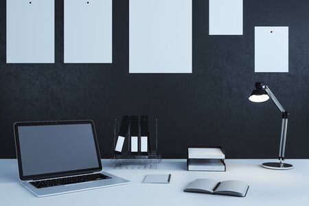 Close up of creative designer workplace with empty laptop and supplies. Mock up, 3D Rendering Stock Photo