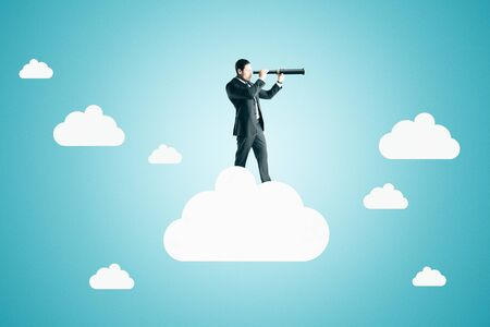 Side view of young businessman on abstract cloud looking into the distance on blue background. Research and success concept