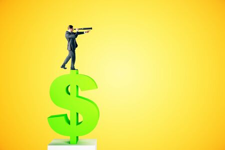 Side view of young businessman silhouette standing on dollar sign and looking into the distance on yellow background. Research and income concept 版權商用圖片