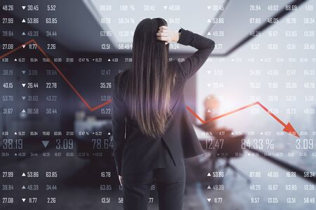 Back view of young businesswoman on blurry office interior background with economic decline. Economy and finance concept. Double exposure