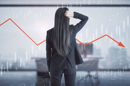 Back view of young businesswoman on blurry office interior background with economic decline. Economy and invest concept. Multiexposure Stock Photo