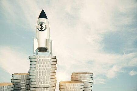 Creative dollar rocket on silver coins stack. Sky with clouds background. Startup and venture capital concept. 3D Rendering Stock Photo