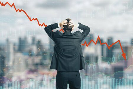 Back view of stressed young businessman looking at downward red arrow on blurry city background. Decrease, stats and investment concept. Double exposure