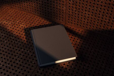 Empty black hardcover book on grunge background with shadows. Education and ad concept. Mock up, 3D Rendering