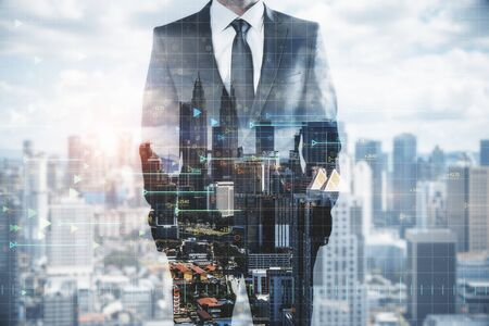 Businessman standing on abstract Kuala Lumpur city background with digital arrows. Big data concept. Double exposure 版權商用圖片