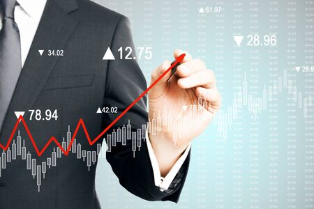 Businessman hand drawing creative upward red chart arrow on blurry business chart background. Increase and stats concept. Double exposure Imagens