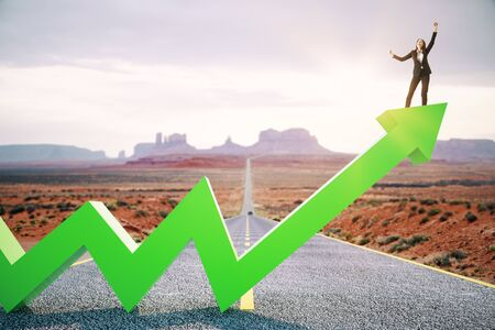 Happy businesswoman standing on upward green arrow on abstract road and desert background. Growth, development, success and increase concept.