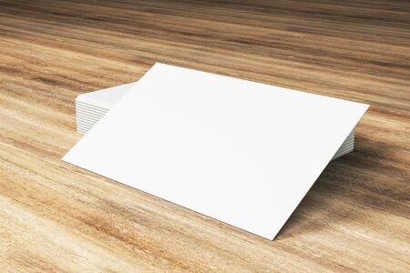 Close up of blank white business card stack on wooden desktop. Info and address concept. Mock up, 3D Rendering