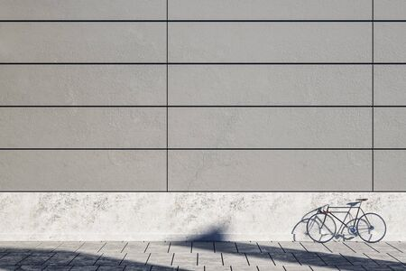 Blank concrete exterior wall with bicycle on street, empty copyspace and sunlight. Mock  up, 3D Rendering Stock Photo