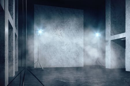Misty concrete interior with professional lighting equipment, copy space and smoke. 3D Rendering Stock Photo