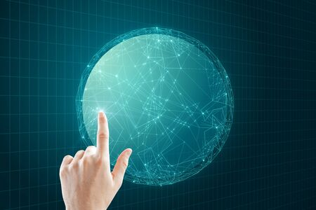 Hand pointing at creative glowing polygonal globe on dark background. AI and data concept.