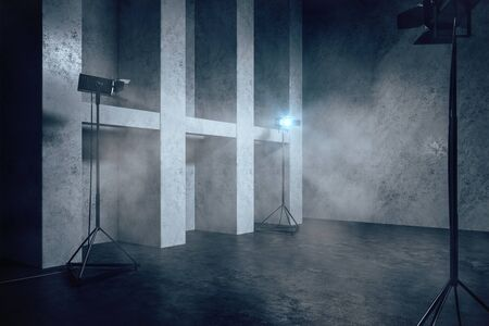 Grey concrete interior with professional lighting equipment, copy space and smoke. 3D Rendering Stock Photo