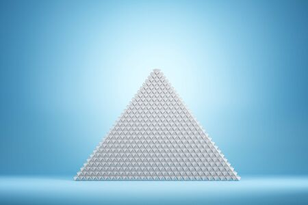 Abstract white pyramid on blue background. Geometry and design concept. 3D Rendering Reklamní fotografie